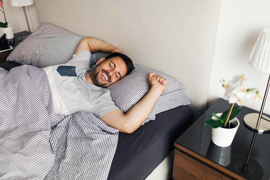 man waking up with a morning stretch